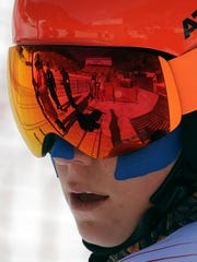 Mikaela Shiffrin of the United States with her face covered in tape as protection from the cold during an inspection of the giant slalom course at the Yongpyong Alpine Center at the 2018 Winter Olympics in Pyeongchang, South Korea, Sunday, Feb. 11, 2018. (AP Photo/Michael Probst)