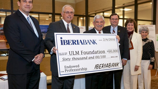 from left: Greg Kahmann, Malcolm Maddox, Nick Bruno, Ronald Berry, Anne Lockhart and Susan Chappell are present at a check presentation to the ULM Foundation from Iberia Bank.