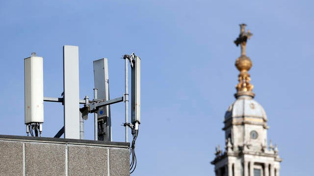 """Mobile network phone masts are visible in front of St Paul's Cathedral in the City of London, Tuesday, Jan. 28, 2020. The Chinese tech firm Huawei has been designated a """"high-risk vendor"""" but will be given the opportunity to build non-core elements of Britain's 5G network, the government has announced. The company will be banned from the """"core"""", of the 5G network, and from operating at sensitive sites such as nuclear and military facilities, and its share of the market will be capped at 35%."""