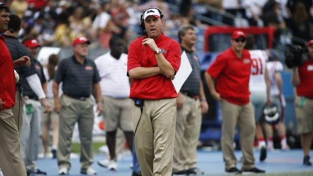 Mississippi head coach Hugh Freeze walks the sideline in the first quarter of an NCAA college football game against Vanderbilt Saturday, Sept. 6, 2014, in Nashville, Tenn. (AP Photo/Mark Humphrey)