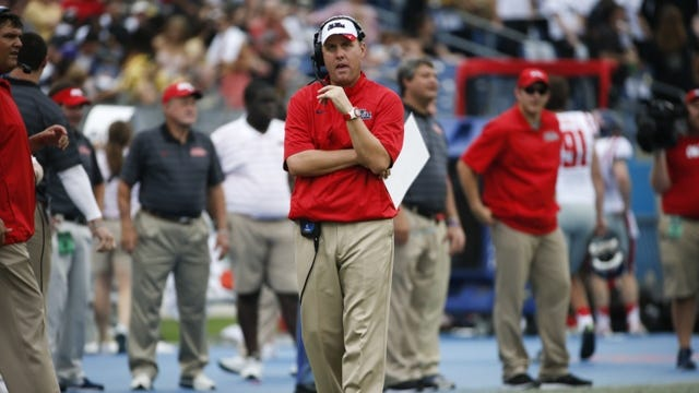 Mississippi head coach Hugh Freeze walks the sideline in the first quarter of an NCAA college football game against Vanderbilt Saturday, Sept. 6, 2014, in Nashville, Tenn. (AP Photo/Mark Humphrey)