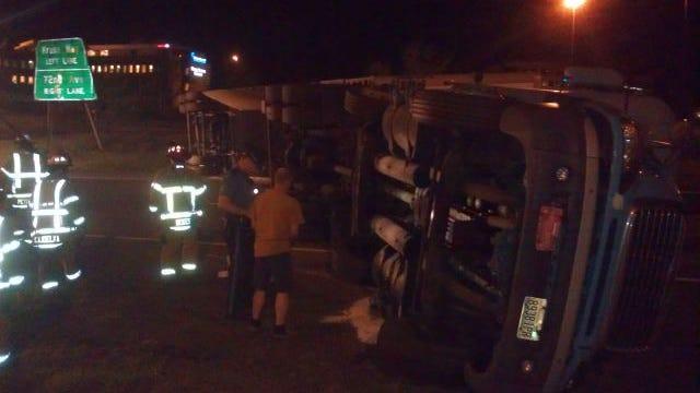 Semi truck overturns in Tigard
