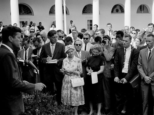 File: President John Kennedy gives a personal farewell message to 80 Peace Corps volunteers in the White House Rose Garden Aug. 28, 1961, before their departure the following day for assignments in Africa. (AP Photo/William J. Smith, File)