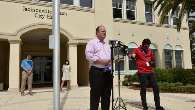 """Jacksonville Beach Mayor Charlie Latham, pictured here at June news conference in front of City Hall, called it a """"proud day"""" when the city became debt-free on Thursday."""