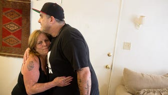 Dorothy Edwards, left, gives a hug to Housing Works caseworker Shawn Morrissey before Morrissey leaves her apartment in Pasadena, California.