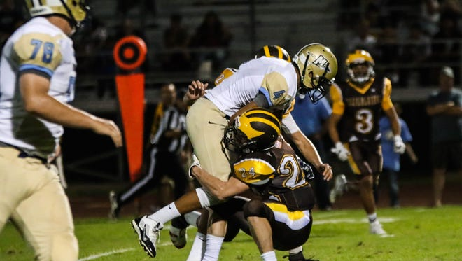 Golden West linebacker Joshua Summers (24) makes a tackle against Monache earlier this season.