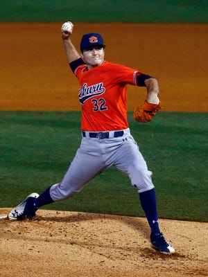 Auburn pitcher Casey Mize throws a pitch during the first inning of a Southeastern Conference tournament NCAA college baseball game against Texas A&M, Thursday, May 24, 2018, in Hoover, Ala.