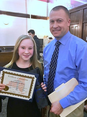 Elmira Police Chief Joseph Kane joins new Elmira Youth Court member Isabella Griffin following Wednesday's induction ceremony.