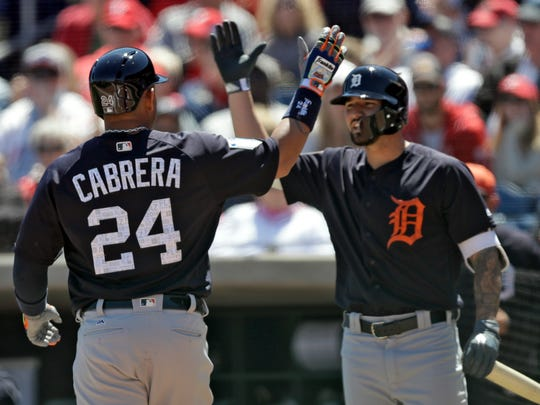 Tigers first baseman Miguel Cabrera (24) high fives Nick Castellanos after Cabrera hit a home run off Phillies starting pitcher Jake Arrieta during the first inning of the Tigers' 6-2 exhibition win on Thursday, March 22, 2018, in Clearwater, Fla.