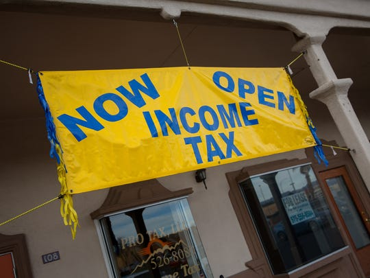 A sign advertising income tax preparation help outside the Pro Tax offices on Lohman Avenue.