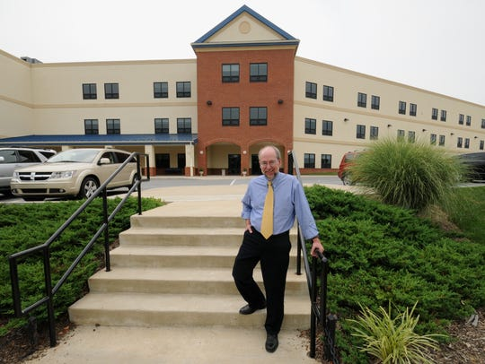 Greg Meece, head of school at Newark Charter School, poses for a picture in front of the school in 2016.