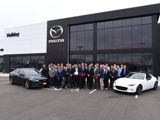 636606753608450298-Holiday-Mazda-Ribbon-Cutting-April-27-2018-Press-Release.jpg