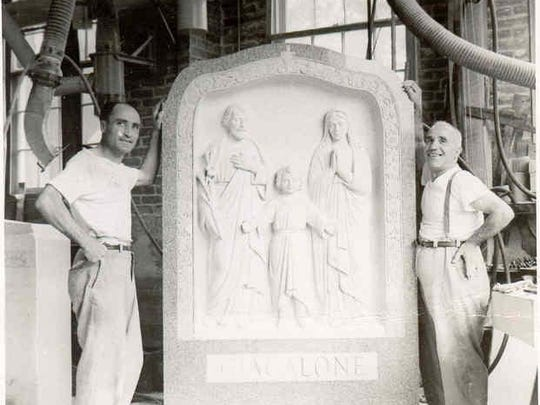 Angelo Bardelli and Orazio Marselli stand by a finished headstone. Note the ventilation systems behind them, installed to combat deadly silica dust.