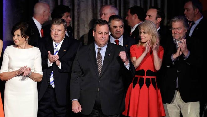 New Jersey Gov. Chris Christie pumps his fist as President-elect Donald Trump gives his acceptance speech during his election night rally, Wednesday, Nov. 9, 2016, in New York.