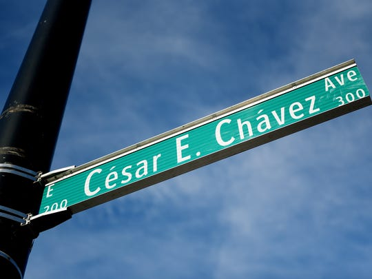 The sign for Cesar E. Chavez Avenue is now in place at the intersection of Cesar E. Chavez Avenue and Turner Street in Old Town Lansing on Tuesday, Jan. 3, 2018.