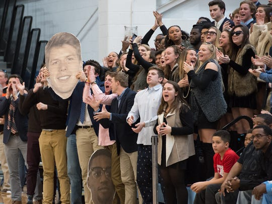 Cape Henlopen fans cheer for their team before the