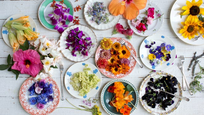 """Edible flowers add a pop of color and flavor to your cooking. Find recipes in """"Cooking with Flowers"""" by Miche Bacher."""