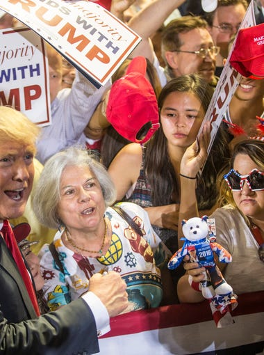 Donald Trump takes a picture with Diana Brest of Phoenix during a Presidential rally on Saturday, June 18, 2016 at the Veterans Memorial Coliseum in Phoenix, Ariz.