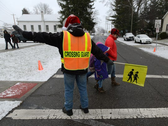 Steve Williams stops traffic so children and parents
