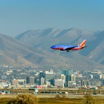 A jet prepares to land at Salt Lake International Airport on Nov. 25, 2013.
