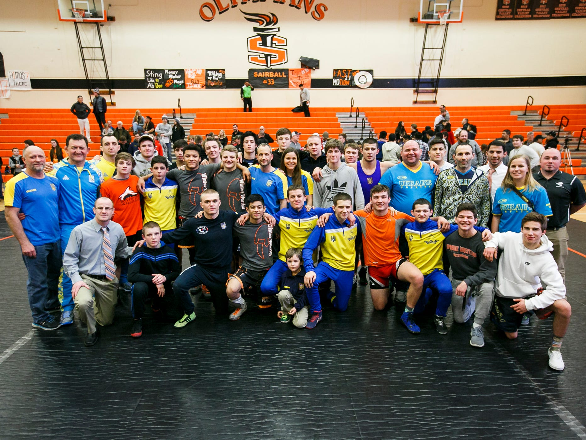 Members of the Ukrainian Junior National Team and Salem Area All-Stars pose for a photo after a friendly match up at Sprague High School on Tuesday, March 8, 2017. Members of the Ukrainian team will now head to Roseburg for another match up, this time against the Roseburg Area All-Stars.