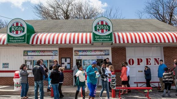 Rita's on Maryland Avenue usherd in a chilly, windy spring in 2014 with their customary giveaway. Rita's is giving away free water ice again this year on Friday, the first day of Spring.