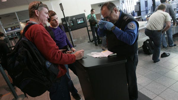 A security agent checks documents at El Paso International Airport in 2010.
