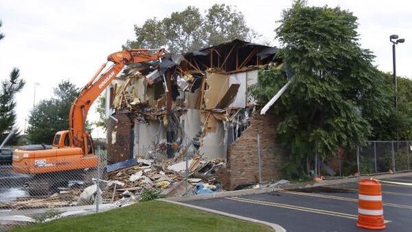 Demolition begins.