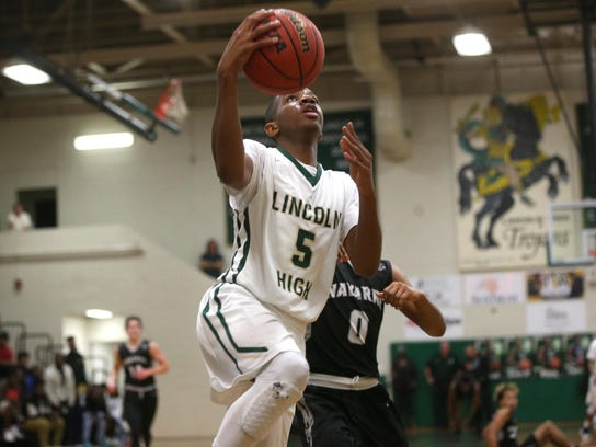Lincoln's Tionne Rollins lays the ball up against Navarre