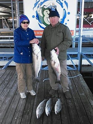 Carol and Joe show off their striper catch from a recent trip on Norfork Lake.