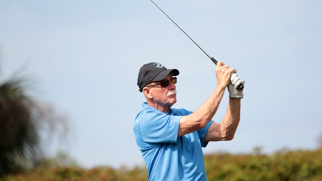 Former Miami Dolphins safety Dick Anderson tees off at the Earl Morrall Celebrity Golf Tournament at The Strand in Naples on Monday. All proceeds from the tournament go to the United Way of SWFL, Drug Free Collier and Caring for Kids of the NFL Alumni.