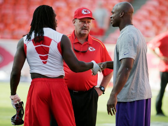 Kansas City's Jamaal Charles, left, shakes hands with