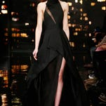 A model walks the runway during the presentation of the Donna Karan New York Fall 2015 collection in New York, Monday, Feb. 16, 2015. (AP Photo/Kathy Willens)