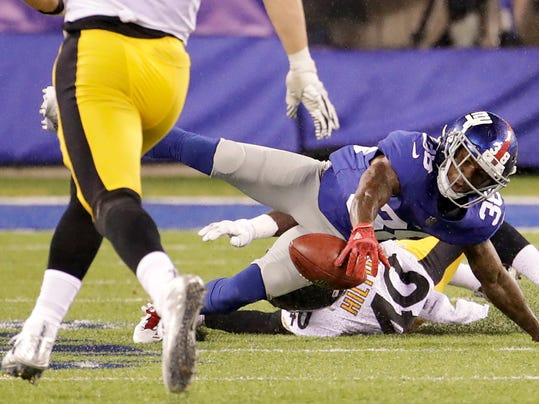 New York Giants defensive back Donte Deayon (38) muffs a punt by the Pittsburgh Steelers during the second quarter of a preseason NFL football game, Friday, Aug. 11, 2017, in East Rutherford, N.J. The Steelers recovered the ball on the play. (AP Photo/Julio Cortez)