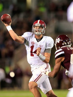 Alabama Crimson Tide quarterback Jake Coker (14) passes the ball against Mississippi State Bulldogs at Davis Wade Stadium. The Crimson Tide defeated the Bulldogs 31-6.