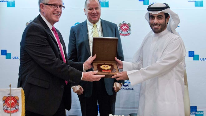 Canaveral Port Authority Chairman Jerry Allender Gulftainer Managing Director Peter Richards and Sheikh Khaled Bin Abdullah Al Qasimi of the Department of Seaports & Customs of the Government of Sharjah exchange plaques during a sister ports signing ceremony in Sharjah, United Arab Emirates.