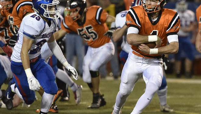 Ashland High School quarterback Grant Denbow will stay home as part of coach Lee Owens' newest recruiting class at Ashland University.