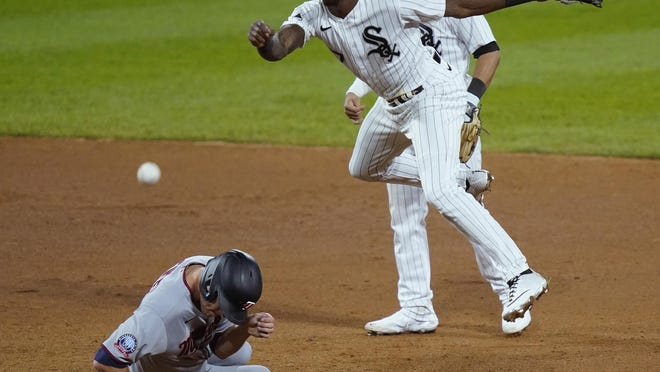 Chicago White Sox shortstop Tim Anderson, center, turns a double play, forcing out Minnesota Twins' Max Kepler, left, at second base and getting Josh Donaldson at first, as second baseman Nick Madrigal watches during the fifth inning Monday in Chicago.