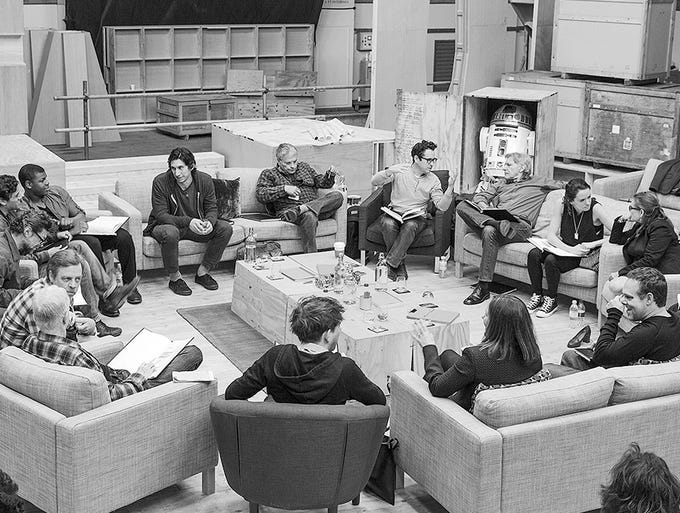 "Disney announced the cast of ""Star Wars: Episode VII"" on April 29. The list includes the original Luke, Leia and Han as well as a few new faces. Here, director J.J. Abrams, center, meets with the cast, including Adam Driver, Oscar Isaac, Andy Serkis, Domhnall Gleeson, Max von Sydow, John Boyega, Daisy Ridley, Harrison Ford, Carrie Fisher, Mark Hamill, Anthony Daniels, Peter Mayhew and Kenny Baker."