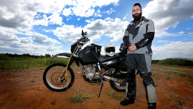 Corey Gamache wears his protective gear, including a tech suit, body armor underneath and protective boots. He also modified his dual sport motorcycle to make a 5,000-mile journey across the Trans-America Trail.