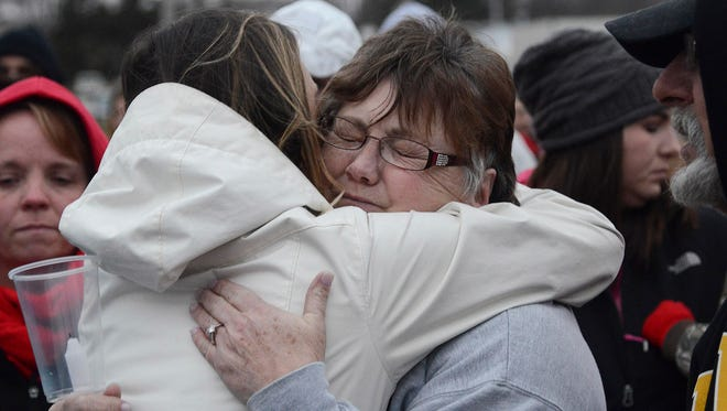 Dozens of community members hugged Beth Fry, whose daughter, son-in-law and two grandchildren died of toxic gas inhalation in Mexico, during a vigil Sunday, March 25, 2018, at the Veterans of Foreign Wars baseball field in Creston, Iowa.