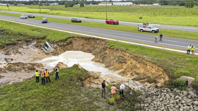 A sink hole opened up in the 7500 block of Baseline Road in Ocala late Tuesday afternoon.