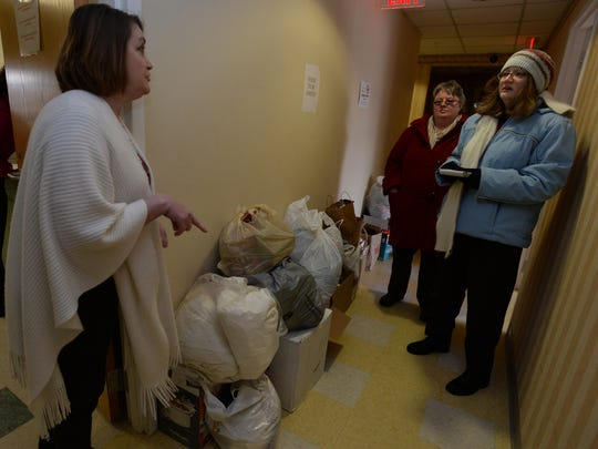 Lisa Yoder, left, talks with Palladium-Item reporters Rachel E. Sheeley and Millicent Martin Emery, right, after unloading items on March 4 donated to the Genesis women's shelter through the 12 Months of Giving program.