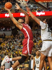 Alabama's Galin Smith, left, shoots over Missouri's Dru Smith, right, during the first half of an NCAA college basketball game Saturday, March 7, 2020, in Columbia, Mo. (AP Photo/L.G. Patterson)