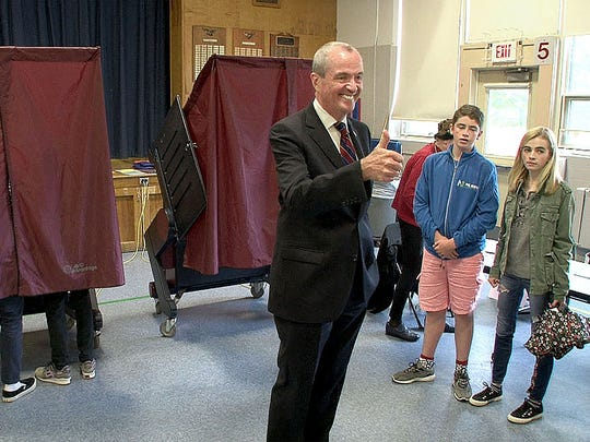Democratic gubernatorial candidate Phil Murphy gives a thumbs up after casting his vote in the primary election at Fairview Elementary School in Middletown on Tuesday.