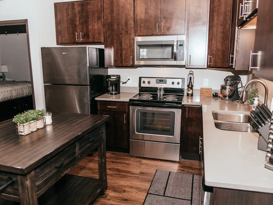 The kitchen and a bedroom in the Brick Towne at Kettlestone