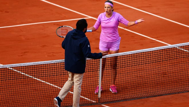 Victoria Azarenka of Belarus disputes a line call in her match against Serena Williams at the 2015 French Open at Roland Garros on May 30, 2015.