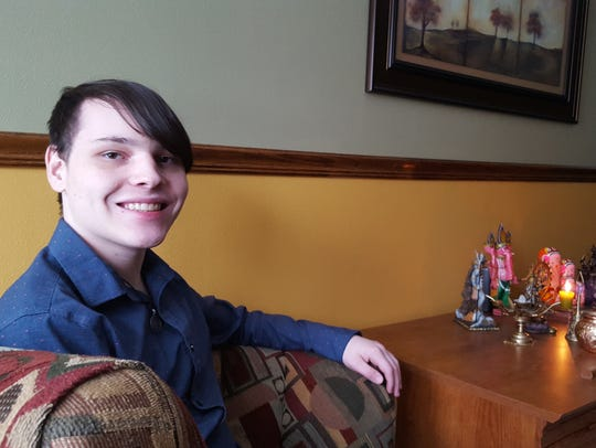 Derek Ziber poses for a photo in his Wausau home, next
