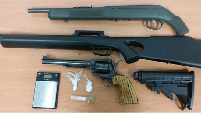 Police seized guns and drugs while conducting a probation compliance check in Desert Hot Springs
