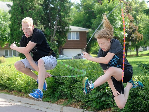 Josiah Abraham and his sister, Caitlyn, show their jump rope tricks in Sioux Falls, S.D., Monday, June 23, 2014. Caitlyn, Noah and Josiah Abraham are training for the national jump rope competition June 26-29 n Brazil.